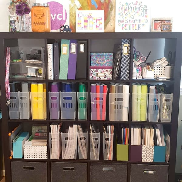 this is a bookcase filled with craft items for a backdrop of my live streaming videos