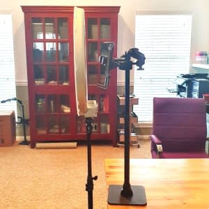 side view of the ring light and arkon remarkable stand setup on a desk