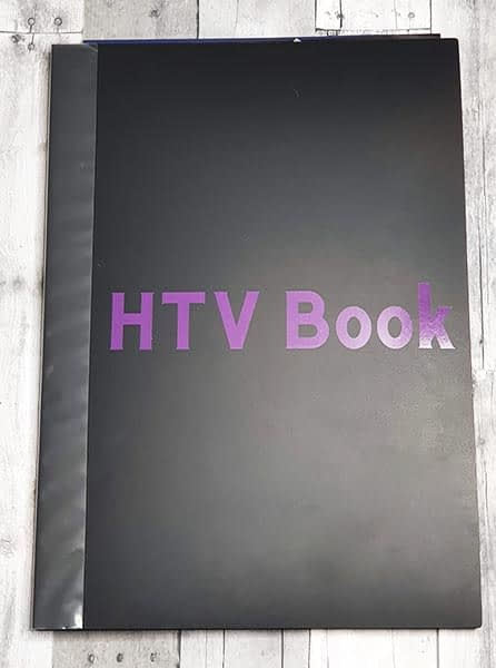Art portfolio with the words HTV book in purple on front